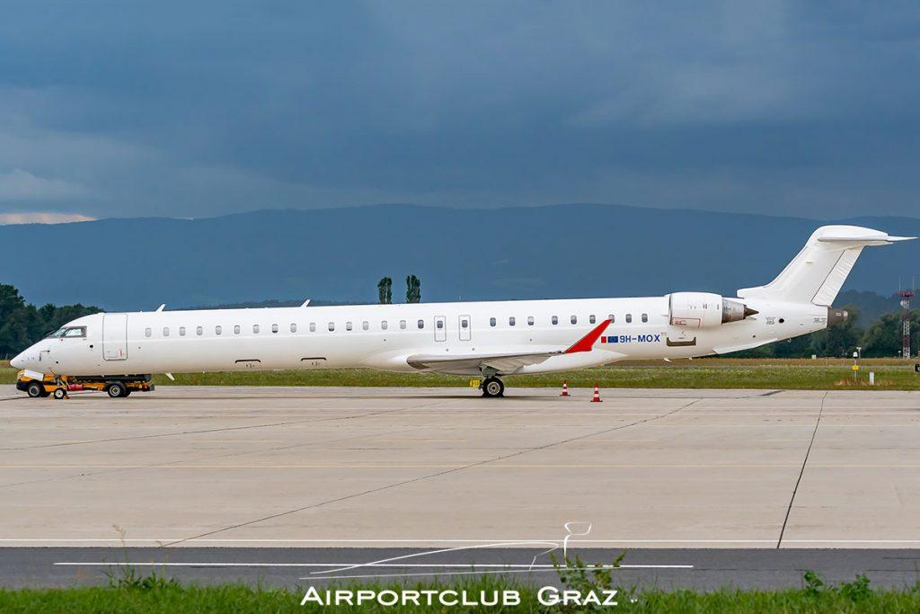 Mel Air CRJ-1000 9H-MOX